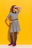 灰色礼服的一点时尚女孩 库存图片