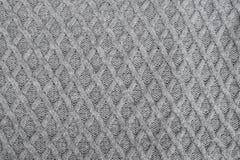 灰色编织的羊毛织品样式 免版税库存图片
