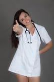 灰色背景医护人员人员护士的妇女医生 免版税库存照片