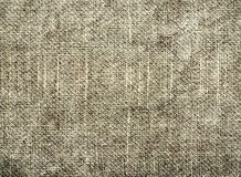 灰色自然纺织品织地不很细背景  库存图片