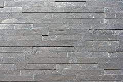 灰色花岗岩铺磁砖了墙壁 库存图片