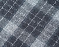 灰色苏格兰人被检查的羊毛织品纹理背景 免版税库存照片