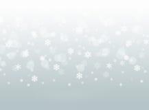 灰色落的雪花抽象冬天bokeh背景 免版税库存照片