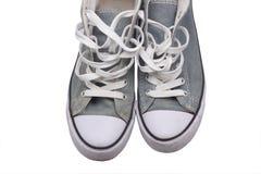 灰色被佩带的运动鞋 免版税图库摄影