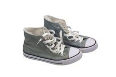 灰色被佩带的运动鞋 库存图片