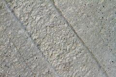 灰色装饰灰泥概略的高度详细的表面为使用作为纹理或背景 免版税库存照片