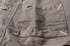 从灰色裤子的大方形的口袋 免版税库存图片