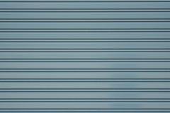 灰色金属路辗快门门或门墙壁关闭了的背景 免版税图库摄影