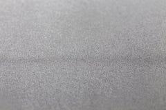 灰色银色金属闪烁发光的现代冷的工业织地不很细背景选择聚焦 库存图片
