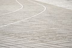 灰色铺磁砖的地板背景 老方形城镇 免版税库存照片