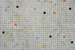 灰色铺磁砖的马赛克墙壁有任意颜色样式背景 库存照片
