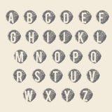 灰色颜色字母表标志在米黄颜色背景设置了 库存图片