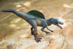 灰色spinosaurus玩具身分 免版税库存照片