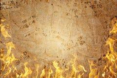 灼烧的报纸有火焰背景 免版税库存图片