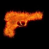 灼烧的枪剪影 免版税库存图片