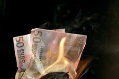 灼烧的欧元 库存图片