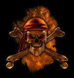 灼烧的海盗头骨 库存照片