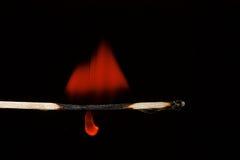 灼烧的火柴梗黑色背景 库存图片