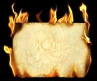 灼烧的老纸张 免版税库存图片