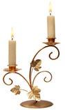 灼烧的老蜡烛葡萄酒金黄烛台。 图库摄影