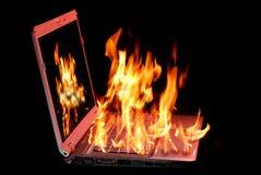 灼烧的膝上型计算机 库存图片