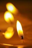 灼烧的蜡烛 熔化的蜡烛 免版税图库摄影