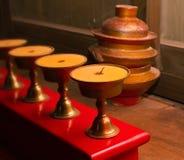 灼烧的黄油水罐闪亮指示幸运的西藏 免版税库存图片