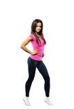 炫耀健身妇女,年轻健康女孩全长画象,是 免版税库存图片