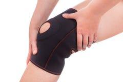 炫耀膝盖的伤害 免版税库存图片
