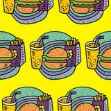 炸薯条、碳酸钠和乳酪汉堡 免版税库存图片