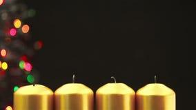 点燃出现的手四个圣诞节蜡烛 影视素材