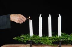 点燃第一个出现蜡烛 库存图片