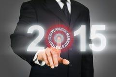 点击在2015年企业目标的商人 库存图片