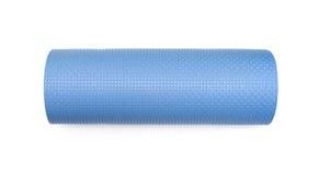 锻炼的蓝色瑜伽席子 免版税图库摄影