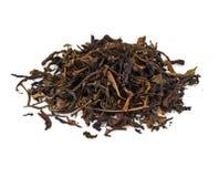 烘干在白色背景隔绝的绿茶叶子 免版税库存图片