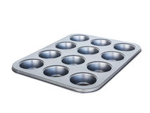 烘烤松饼盘子第12个孔 不粘锅的涂层 隔绝在wh 图库摄影