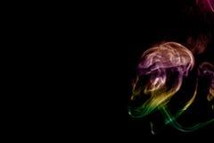 烟型妖怪,黑背景 库存照片