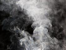 烟的抽象图在黑背景 免版税库存图片