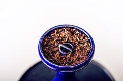 水烟筒和tobacoo 抽烟 拳击拳头现有量人战争 免版税库存照片
