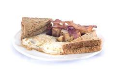 烟肉和鸡蛋多士和马铃薯煎饼 免版税库存照片