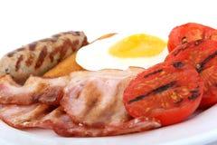 烟肉早餐蛋香肠蕃茄 库存照片