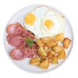 烟肉鸡蛋油煎的土豆 免版税库存照片