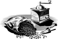 烤咖啡被打开的和一个老磨咖啡器 库存图片