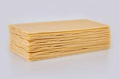 烤宽面条板料在白色背景堆积 免版税图库摄影