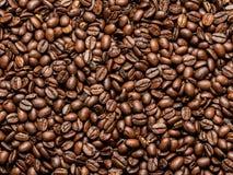 烤布朗咖啡豆背景 免版税图库摄影