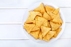 烤干酪辣味玉米片板材  免版税图库摄影