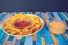 烤干酪辣味玉米片连同垂度 库存照片