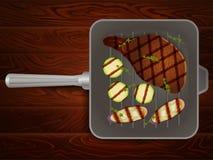 烤平底锅肉牛排麝香草菜木头5 图库摄影