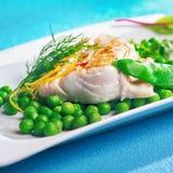 烤或烤箱烘烤了有柠檬味的鱼片 免版税库存图片