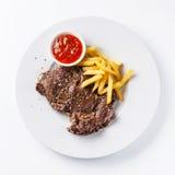 烤牛肉用炸薯条 图库摄影
